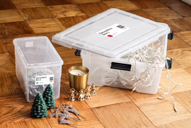 Transparent Storage containers with QL labels for managing holiday decorations