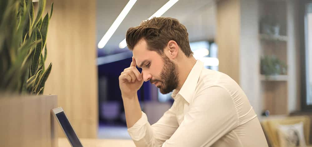 worried man with laptop inventory mistakes
