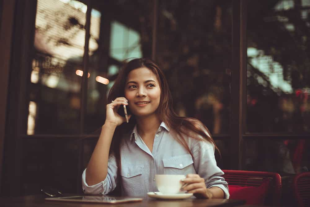 Businesswoman talking on phone working