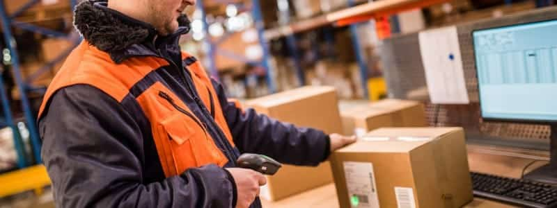 A man uses a barcode scanner to take inventory.